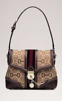 ... , piccola catena, charm e classica tribanda della Casa. Gucci